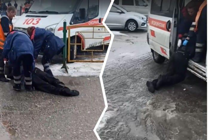 Мужчину до машины скорой помощи волокли по грязи (видео)