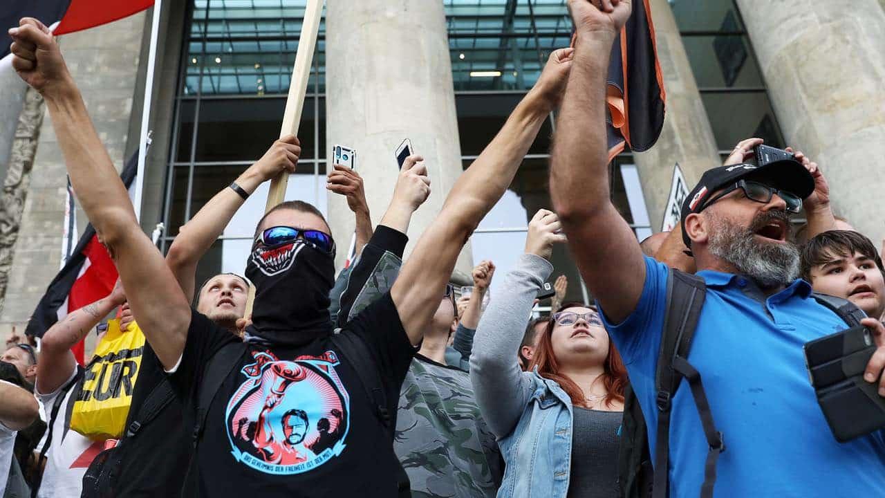 Участники митинга в Германии выкрикивали имя президента Путина